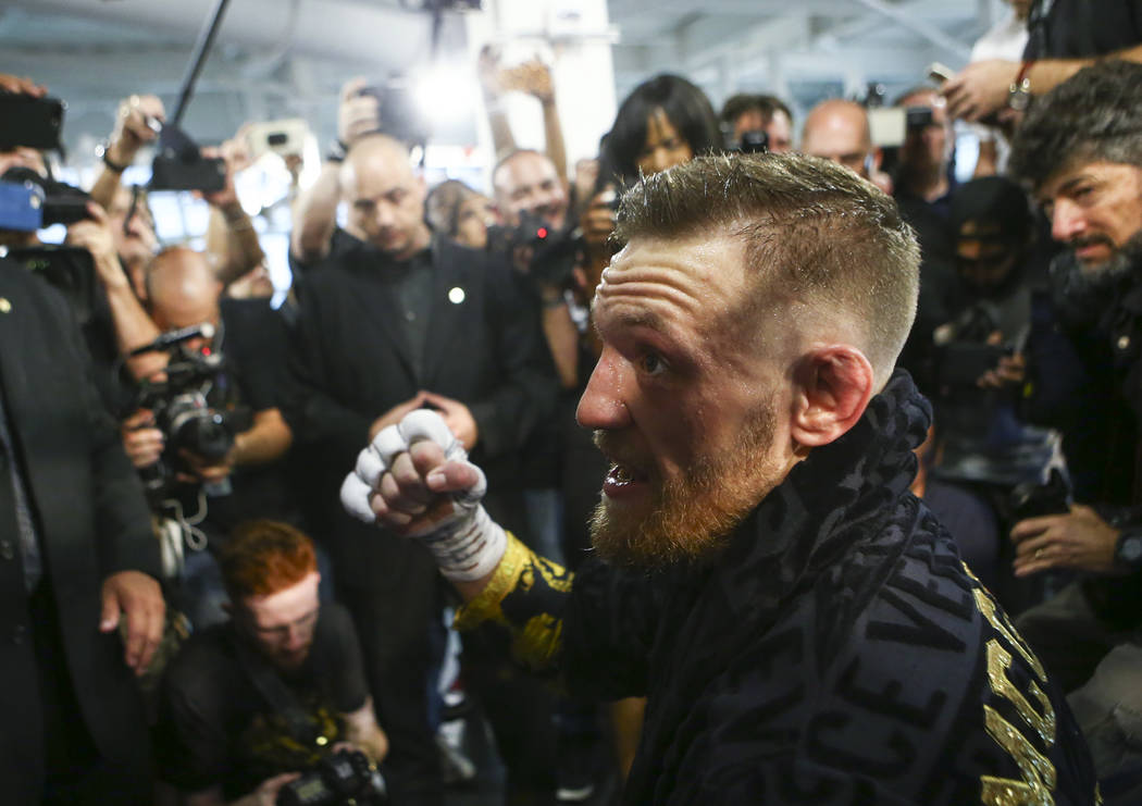 UFC fighter Conor McGregor talks with reporters ahead of his boxing match against Floyd Mayweather Jr., slated for Aug. 26, at the UFC Performance Institute in Las Vegas on Friday, Aug. 11, 2017.  ...