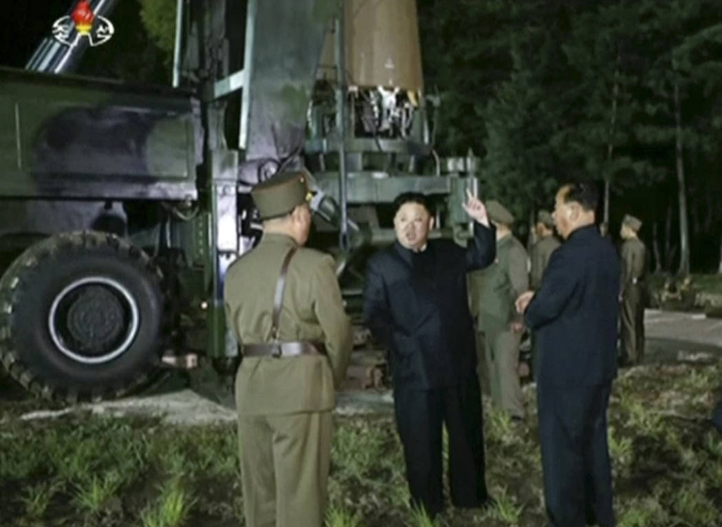 FILE - In this file image made from video by North Korea's KRT released on July 28, 2017, North Korean leader Kim Jung Un, second from right, gestures at the site of a missile test at an undisclos ...