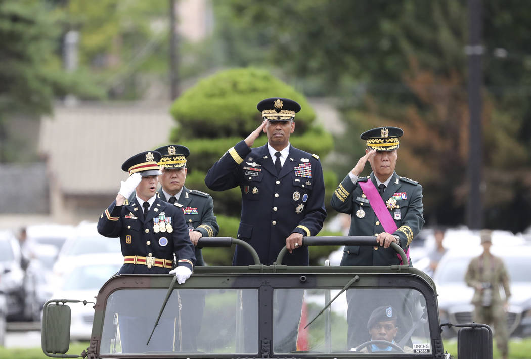U.S. Gen. Vincent Brooks, commander of Combined Forces Command, center, salutes with incoming Deputy Commander Gen. Kim Byung-joo, left rear, and outgoing Deputy Commander Gen. Leem Ho-young, righ ...