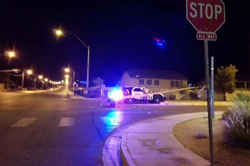 Las Vegas police blocked off a northeast valley neighborhood early Friday morning while they try to coax a man out of house on Waterdragon Avenue. (Mike Shoro/Las Vegas Review-Journal)
