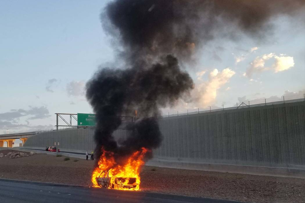 A vehicle caught on fire on U.S. Highway 95 near the Rainbow Boulevard exit on Friday, Aug. 11, 2017. (Patrick Connolly/Las Vegas Review-Journal)