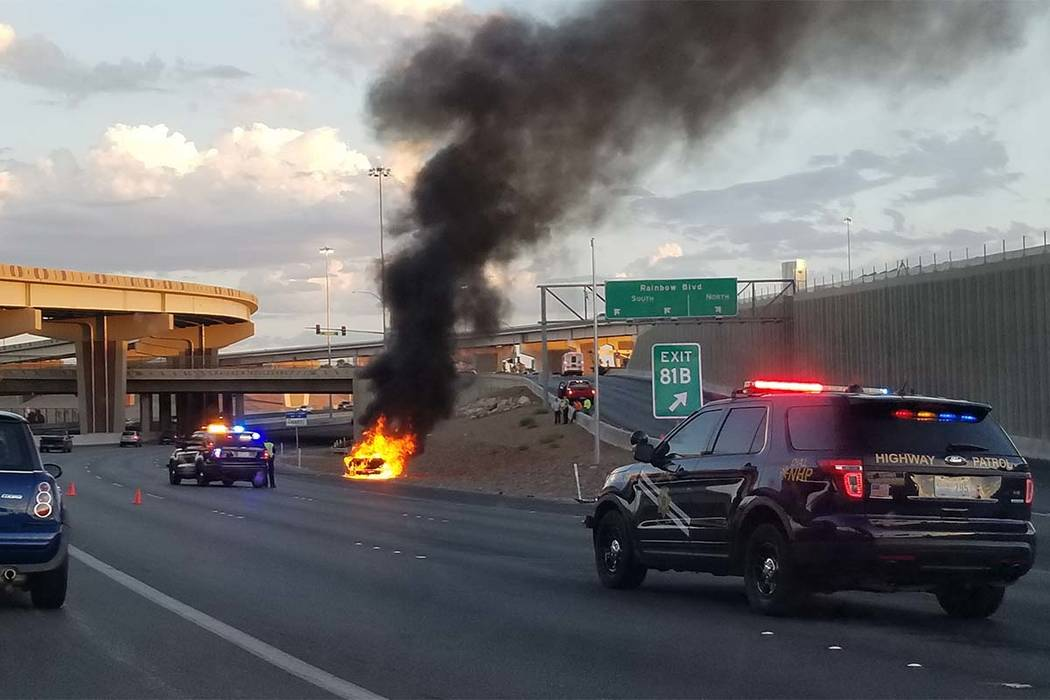 A vehicle fire Friday, Aug. 11, 2017, U.S. Highway 95 north near the Rainbow Boulevard exit has narrowed traffic down to one lane. (Patrick Connolly/Las Vegas Review-Journal)