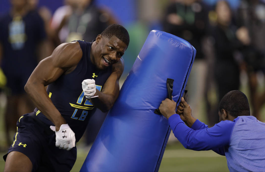 Wake Forest linebacker Marquel Lee runs a drill at the NFL football scouting combine Sunday, March 5, 2017, in Indianapolis. (AP Photo/David J. Phillip)