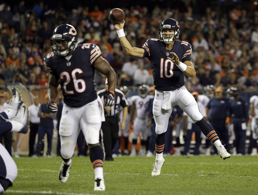 Chicago Bears quarterback Mitchell Trubisky (10) throws a touchdown pass to wide receiver Victor Cruz (80) during the first half of an NFL preseason football game against the Denver Broncos, Thurs ...