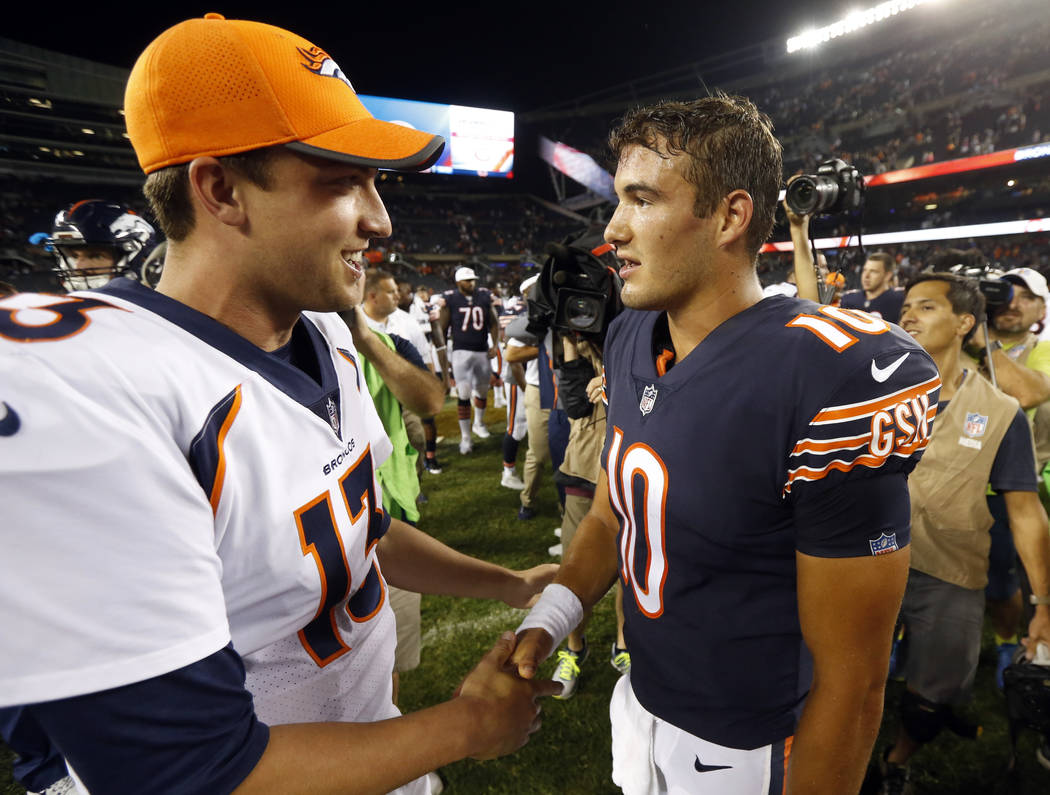 Denver Broncos quarterback Trevor Siemian (13) shakes hands with Chicago Bears quarterback Mitchell Trubisky (10) after an NFL preseason football game, Thursday, Aug. 10, 2017, in Chicago. The Bro ...