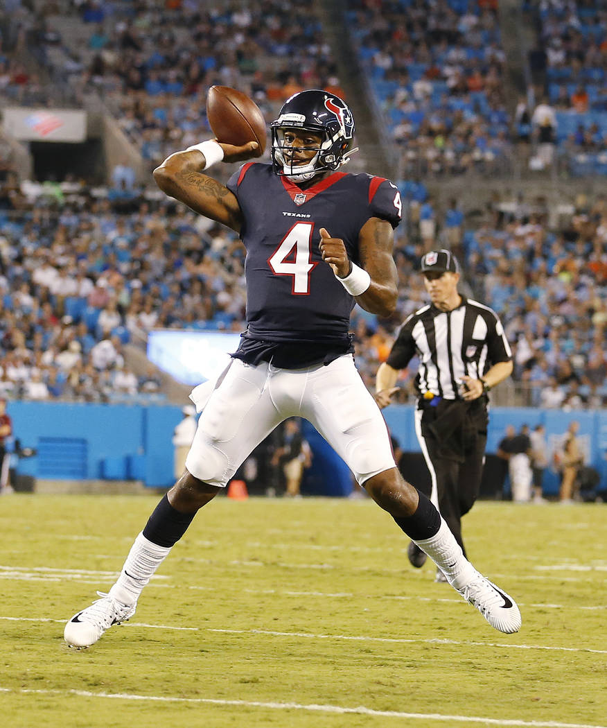 Houston Texans quarterback Deshaun Watson (4) runs out of the pocket against the Carolina Panthers during the first half of an NFL preseason football game, Wednesday, Aug. 9, 2017, in Charlotte, N ...