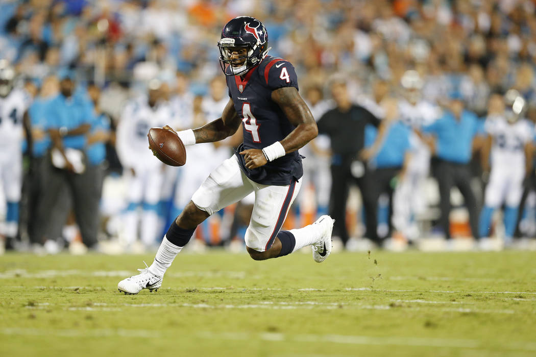 Houston Texans quarterback Deshaun Watson (4) works against the Carolina Panthers during the second half of an NFL preseason football game, Wednesday, Aug. 9, 2017, in Charlotte, N.C. (AP Photo/Ja ...