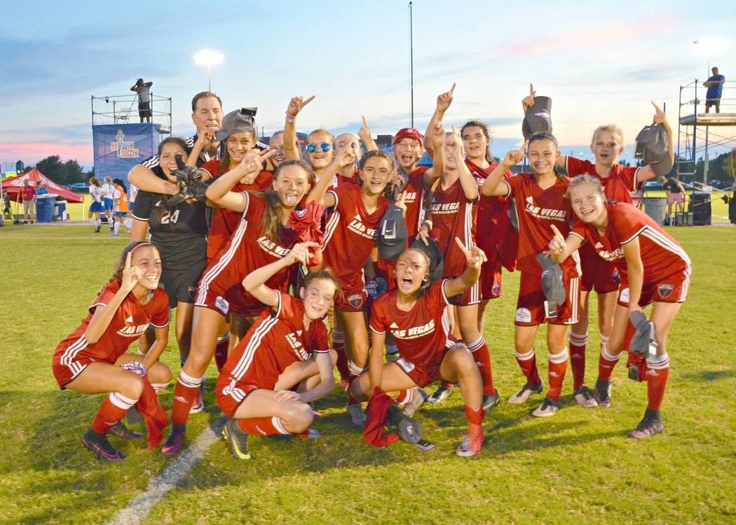 The Championship Winning 03 Girls Red Team Poses After Winning Their Final Game During The