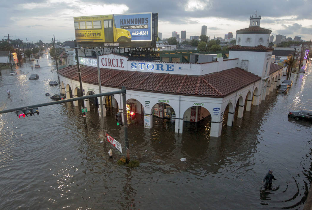 The Circle Food Store is engulfed in floodwaters in New Orleans on Saturday, Aug. 5, 2017. New Orleans Mayor Mitch Landrieu's office said early Thursday, Aug. 10, 2017, the city has lost service t ...