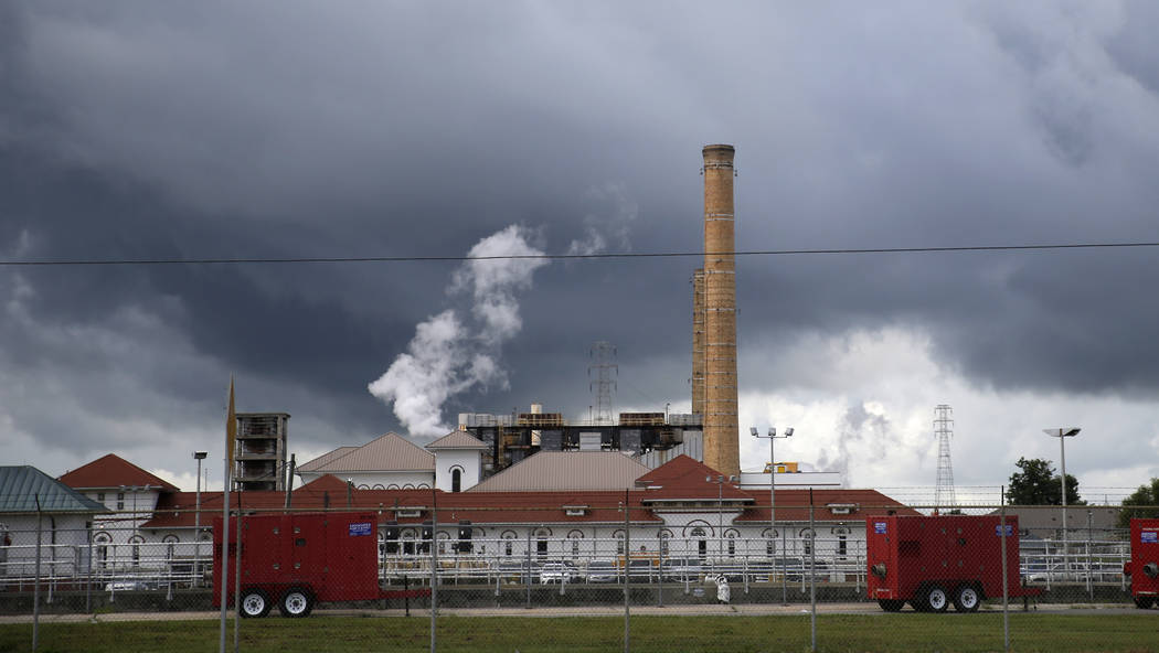 Rain clouds gather over the New Orleans Sewerage & Water Board facility, where turbines that power pumps have failed, in New Orleans, Thursday, Aug. 10, 2017. Gov. John Bel Edwards declared a  ...