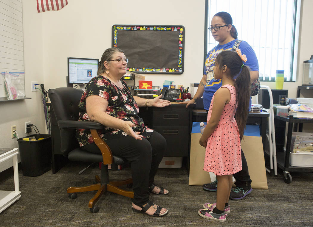 Hi'ilani Bouchan, 7, right, meets her teacher Marie Wise, left, for the first time during an open house at the newly rebuilt Rex Bell Elementary School on Friday, Aug. 11, 2017. Bridget Bennett La ...