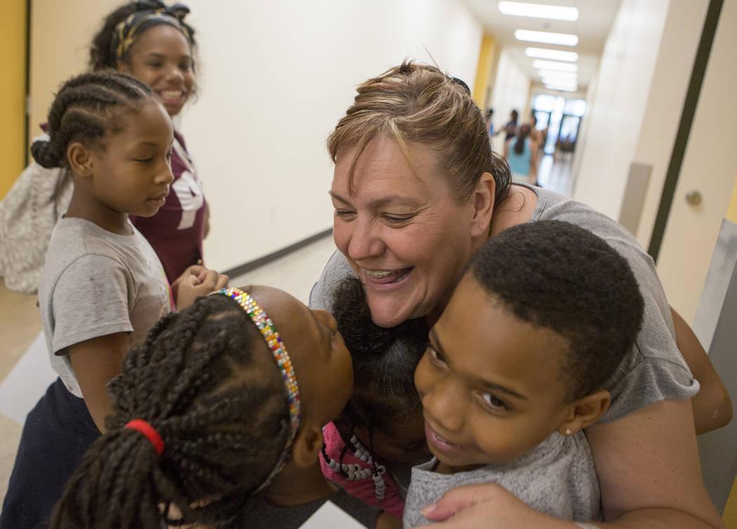 Kindergarten teacher Tasha Thatcher hugs formers students during an open house at the newly rebuilt Rex Bell Elementary School on Friday, Aug. 11, 2017. (Bridget Bennett/Las Vegas Review-Journal @ ...