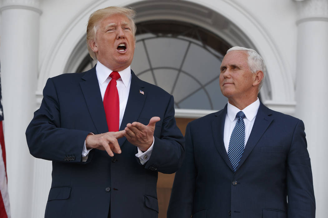 President Donald Trump, accompanied by Vice President Mike Pence, speaks to reporters before a security briefing at Trump National Golf Club in Bedminster, N.J., Thursday, August 10, 2017,  (AP Ph ...