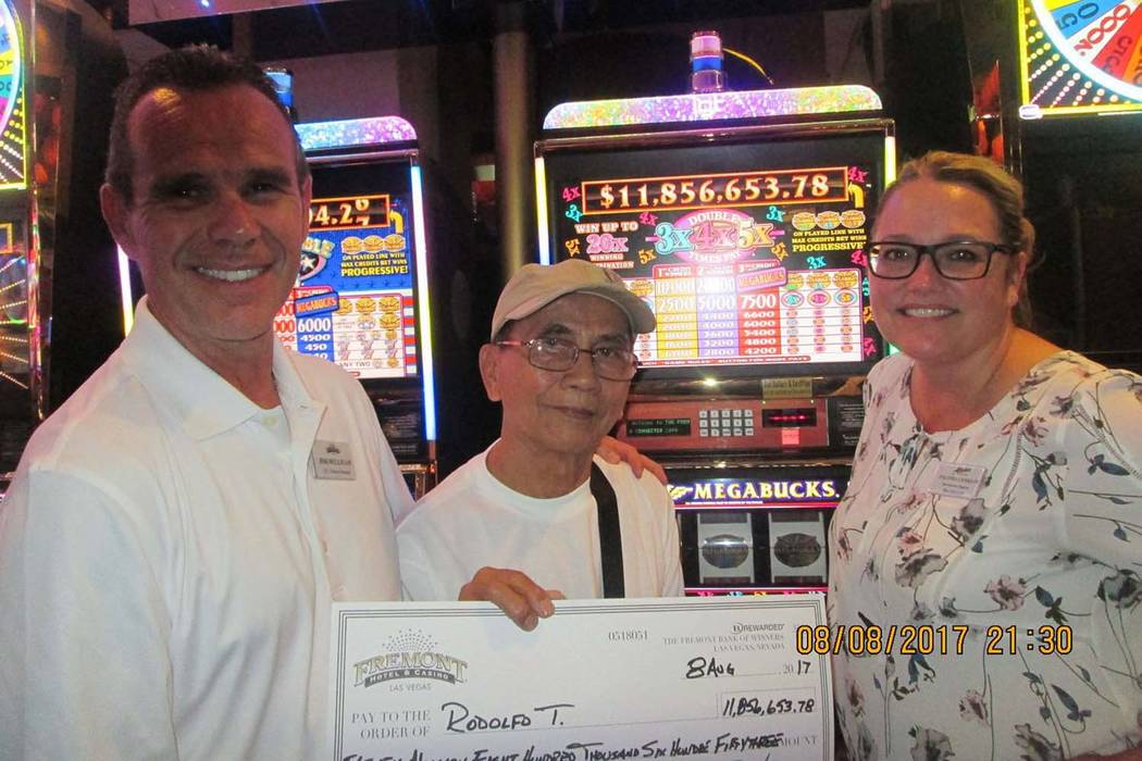 Jackpot winner Rodolfo T., center, receives a check from Fremont vice president and general manager Jim Sullivan and slot director Salinda Conklin, Tuesday, Aug. 8, 2017. Rodolfo won $11.8 million ...