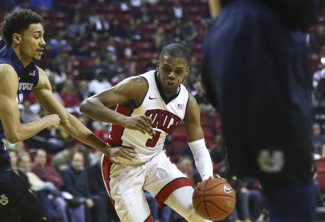 UNLV forward Tyrell Green (3) drives against Utah State during a basketball game at the Thomas & Mack Center in Las Vegas on Wednesday, March 1, 2017. (Chase Stevens/Las Vegas Review-Journal)  ...