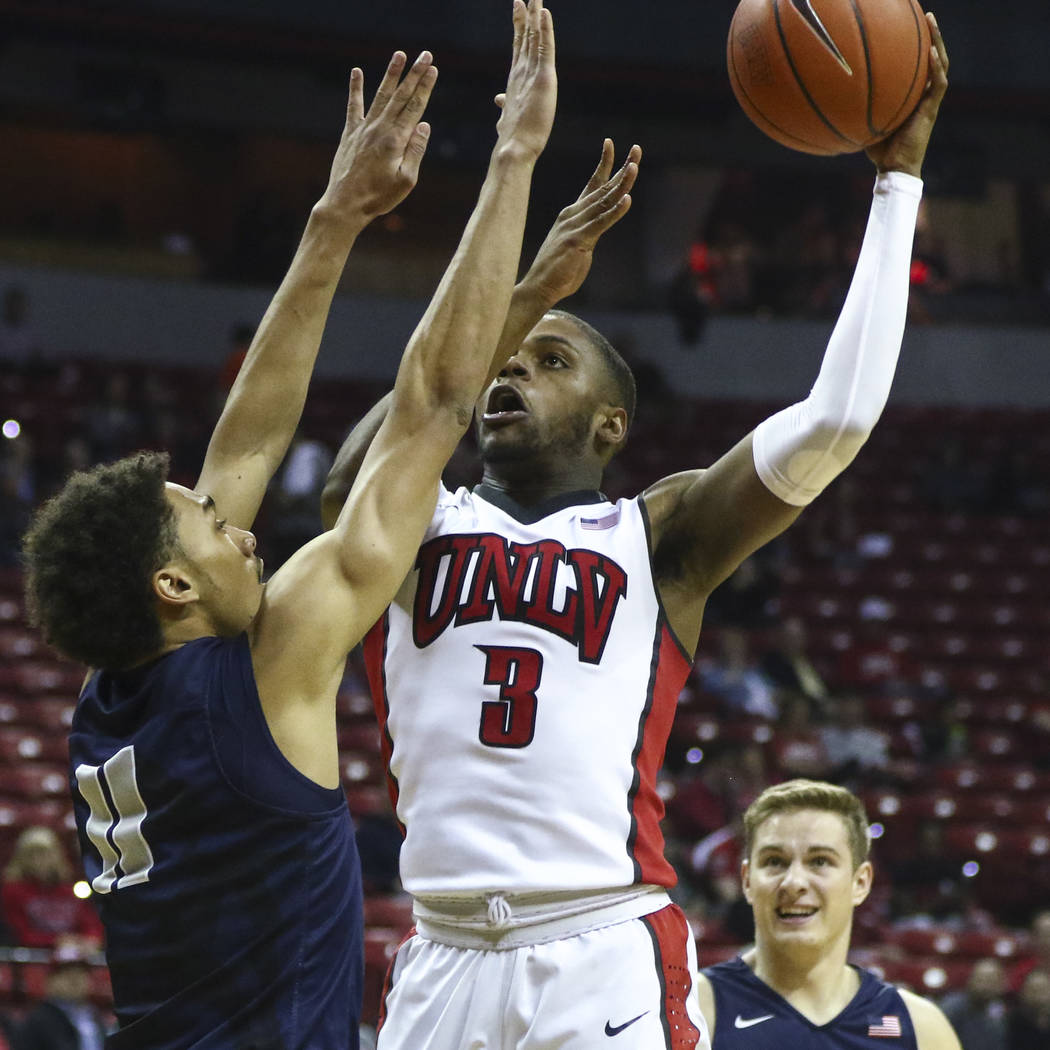 UNLV forward Tyrell Green (3) shoots over Utah State forward Alexis Dargenton (11) during a basketball game at the Thomas & Mack Center in Las Vegas on Wednesday, March 1, 2017. UNLV won 66-59 ...