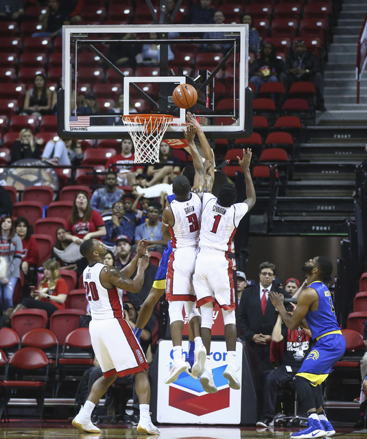UNLV forward Tyrell Green (3) and guard Kris Clyburn (1) defend as a San Jose State sends up a shot during a basketball game at the Thomas & Mack Center in Las Vegas on Saturday, Feb. 11, 2017 ...