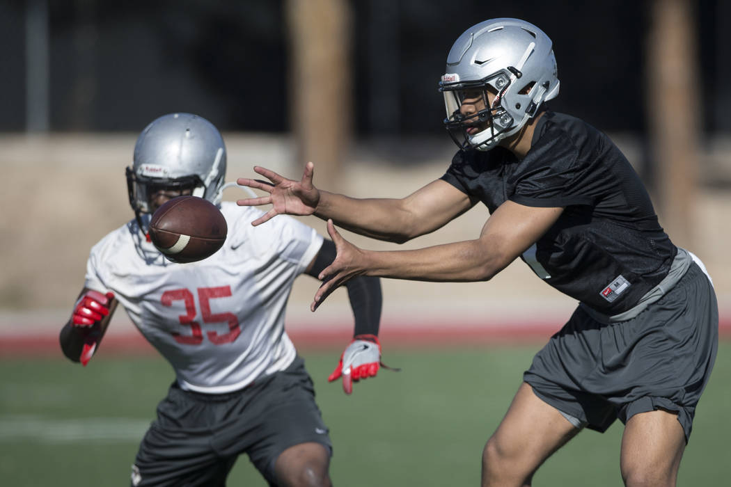 UNLV's quarterback Armani Rogers (1) reaches for a snapped ball during a team practice at Rebel Park in UNLV on Wednesday, March 1, 2017, in Las Vegas. (Erik Verduzco/Las Vegas Review-Journal) @Er ...