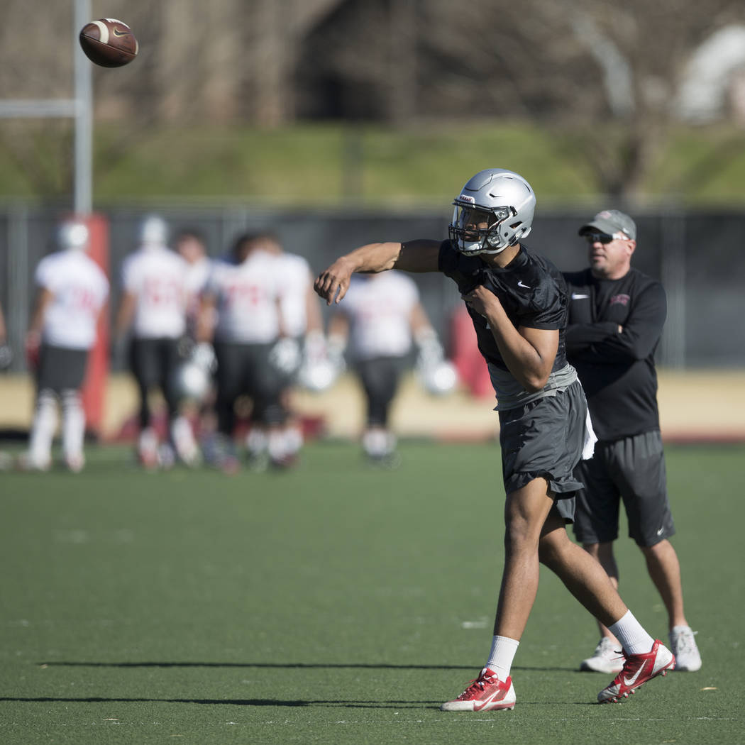 UNLV's quarterback Armani Rogers (1) throws a pass during a team practice at Rebel Park in UNLV on Wednesday, March 1, 2017, in Las Vegas. (Erik Verduzco/Las Vegas Review-Journal) @Erik_Verduzco