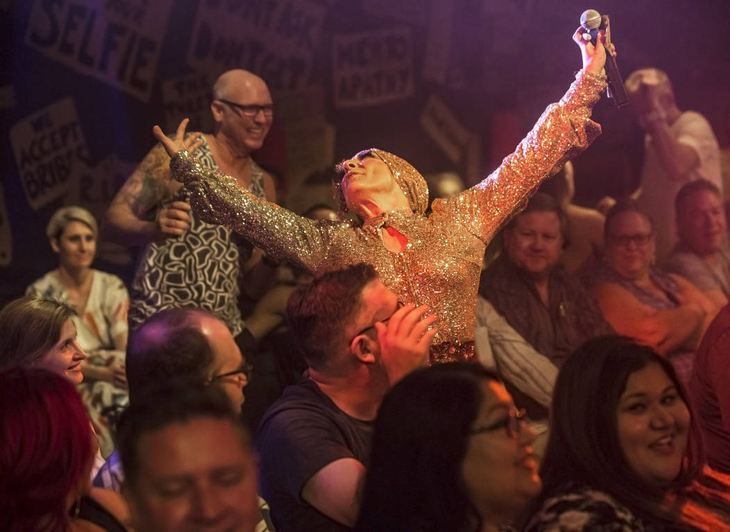 Amy Saunders, middle, dances in the crowd during The Miss Behave Gameshow at The Back Room on Thursday, Aug 10, 2017, at Bally's hotel-casino, in Las Vegas. Benjamin Hager Las Vegas Review-Journal ...