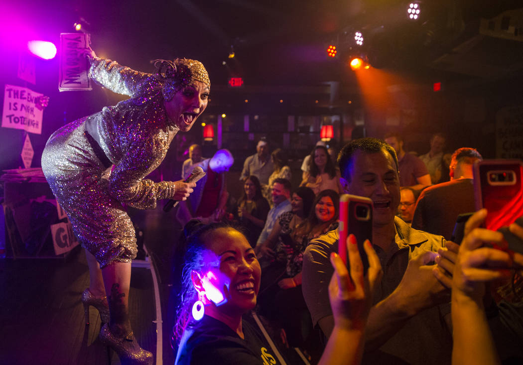 Amy Saunders, left, takes selfies with the crowd at The Miss Behave Gameshow on Thursday, Aug 10, 2017, at The Back Room, at Bally's hotel-casino, in Las Vegas. Benjamin Hager Las Vegas Review-Jou ...