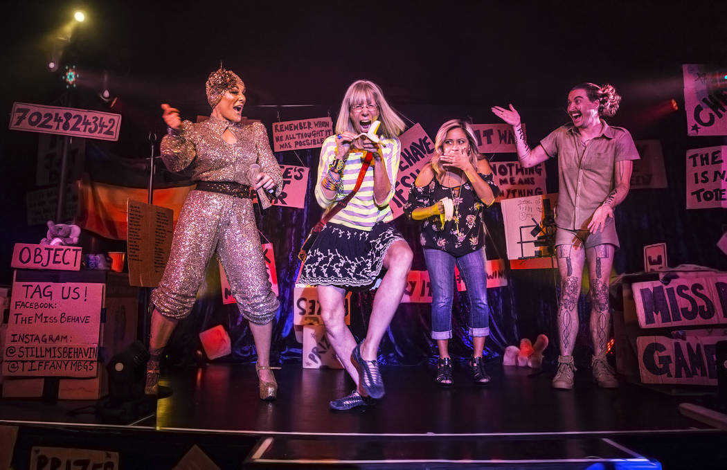 "Amy Saunders, left,  and Bret Pfister, right, cheer for guests doing a ""banana dance"" during The Miss Behave Gameshow at The Back Room on Thursday, Aug 10, 2017, at Bally's hotel ..."