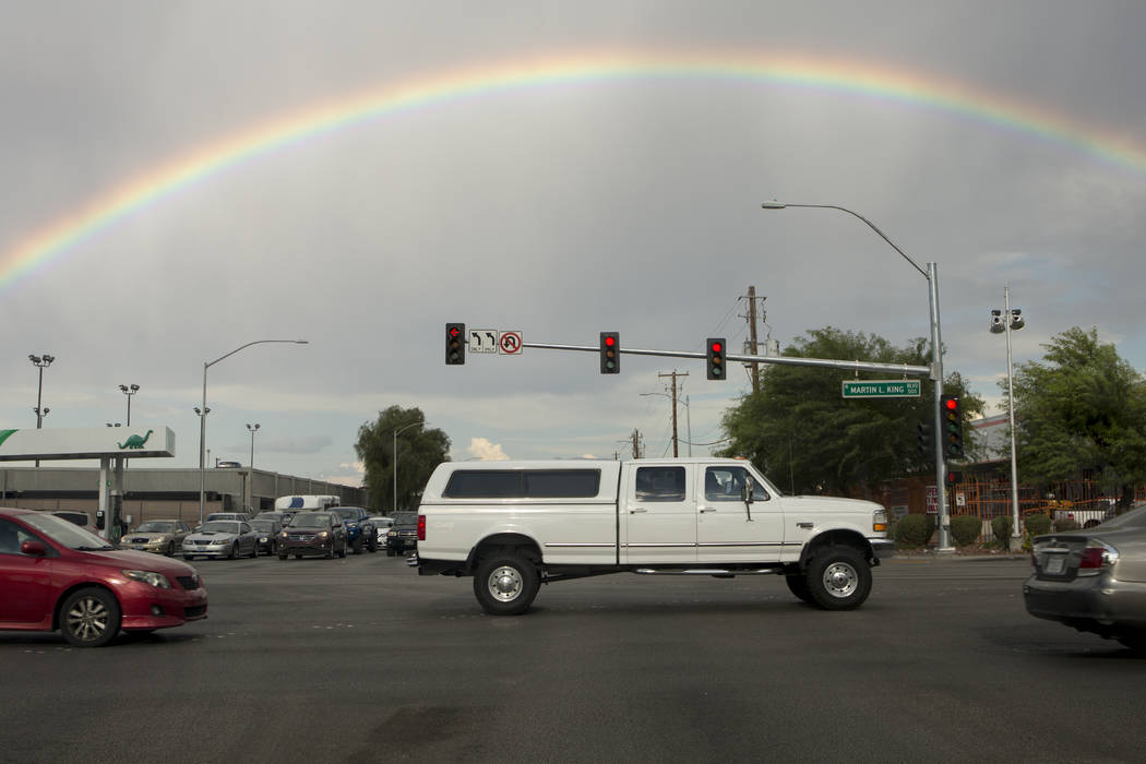 A rainbow arches over a truck as it passes thorugh the intersection of West Bonanza Road and North Martin Luther King Boulevard in Las Vegas on Friday, Aug. 11, 2017. Bridget Bennett Las Vegas Rev ...