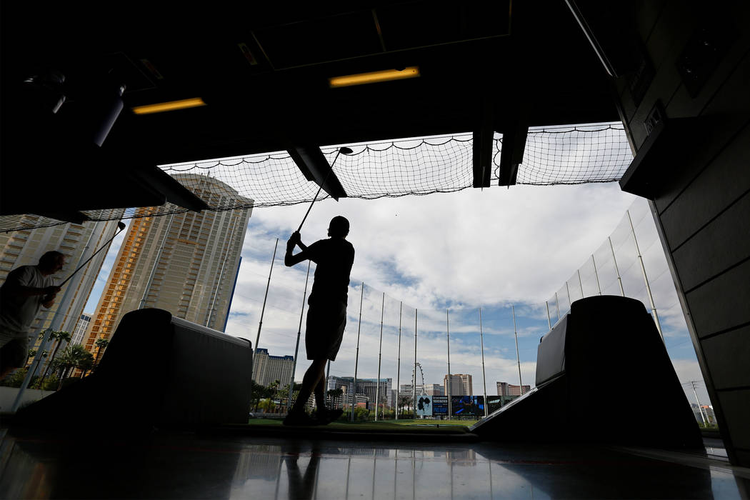 PGA 2017 Fashion & Demo Experience attendee Jack Kolosvary, 17, of Portland Ore., hits a ball at Topgolf in Las Vegas, Monday, Aug. 14, 2017. (Chitose Suzuki/Las Vegas Review-Journal) @chitose ...