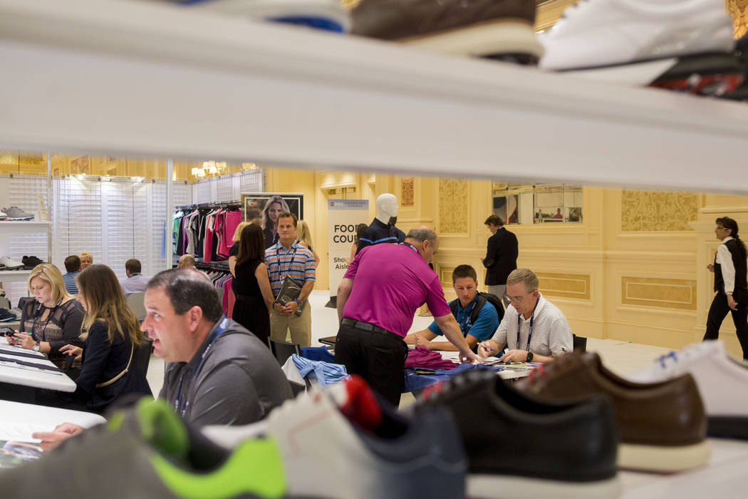 Attendees stop by Callaway Golf Apparel  during the PGA Fashion and Demo Experience at The Venetian in Las Vegas, Tuesday, Aug. 15, 2017. (Elizabeth Brumley/Las Vegas Review-Journal)