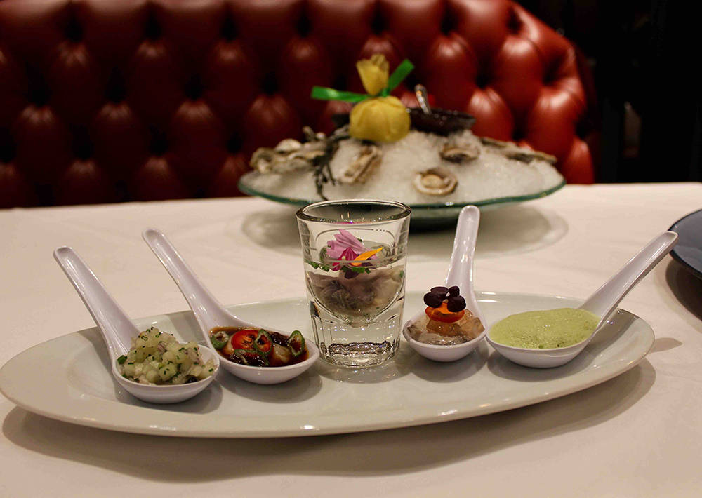 Old Homestead Steakhouse Executive Chef Michael Gill created five different oyster preparations — ponzu-wasabi, cucumber gelee, ginger-beet, lemon gel and anise cream. (Courtesy)