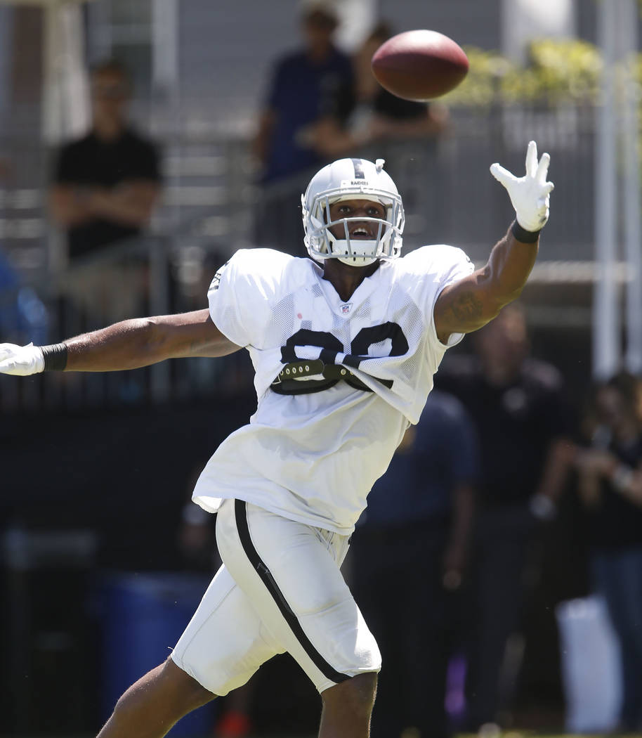 The Oakland Raiders tight end Gabe Holmes keeps his eye on a pass during teams practice at Raiders Napa Valley training complex in Napa, Calif., on Monday, July 31, 2017. Bizuayehu Tesfaye Las Veg ...