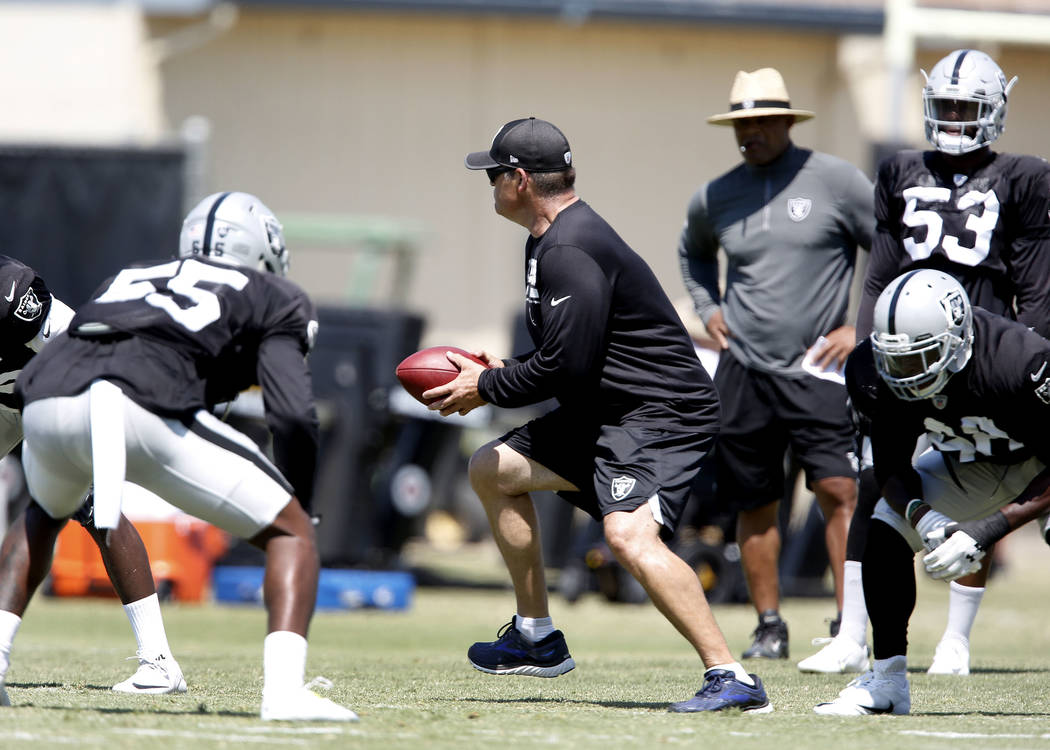 The Oakland Raiders defensive assistant Sam Anno, center, works with his players during teams practice at Raiders Napa Valley training complex in Napa, Calif., on Tuesday, Aug. 1, 2017. Bizuayehu  ...