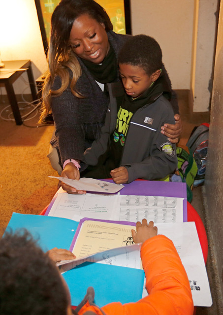 Shannon Churchwell, who supports the Education Savings Account program, talks with her son Rashan, 8, as her another son Randon, 5, foreground, looks on at her home in Las Vegas, Tuesday, Jan. 17, ...