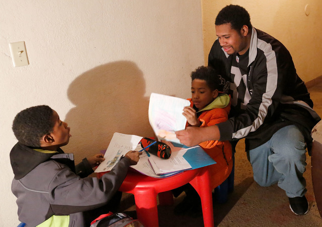 Randy Benson, who supports the Education Savings Account program, talks with his sons Rashan, 8, left, and Randon, 5, at his home in Las Vegas, Tuesday, Jan. 17, 2017. (Chitose Suzuki/Las Vegas Re ...