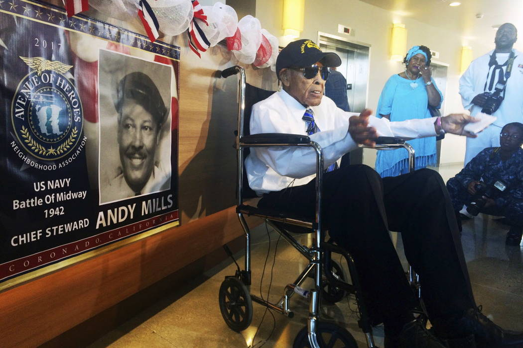 Former Navy Chief Steward Andy Mills, 102, talks to reporters before Navy officials hold a ceremony to name a new barracks after him, a rare honor for a living recipient, at Naval Base Coronado, C ...