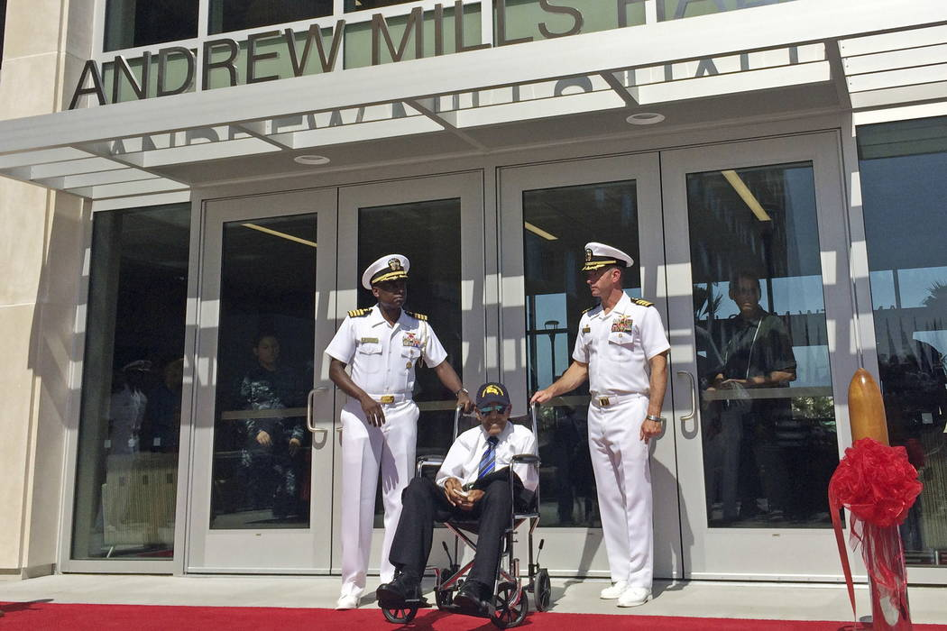 Former Navy Chief Steward Andy Mills, 102, is joined by Navy officers following a ceremony to name a new barracks after him, a rare honor for a living recipient, at Naval Base Coronado, Calif., Th ...