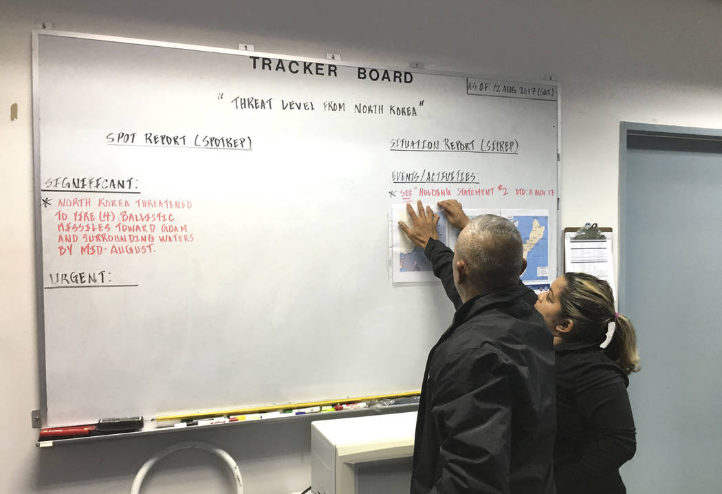 Watch Room staff monitor news and updates and coordinate with agencies on local in an event of emergency Saturday, Aug. 12, 2017 as Guam Homeland Security opens its 24-hour Watch Room operation in ...
