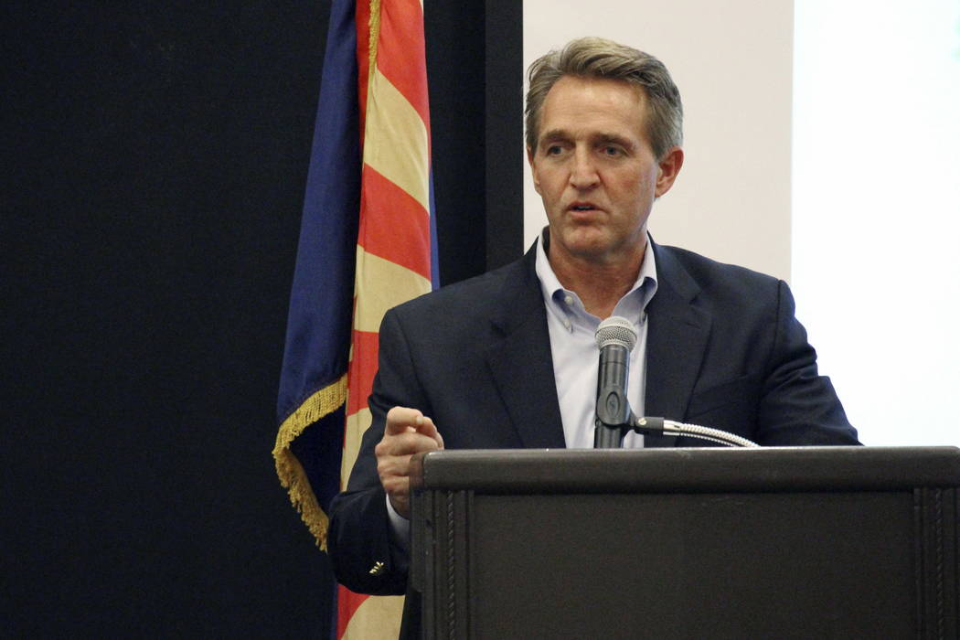 U.S. Sen. Jeff Flake addresses business officials gathered for an event in Prescott, Ariz., Thursday, Aug. 10, 2017. (AP Photo/Bob Christie)