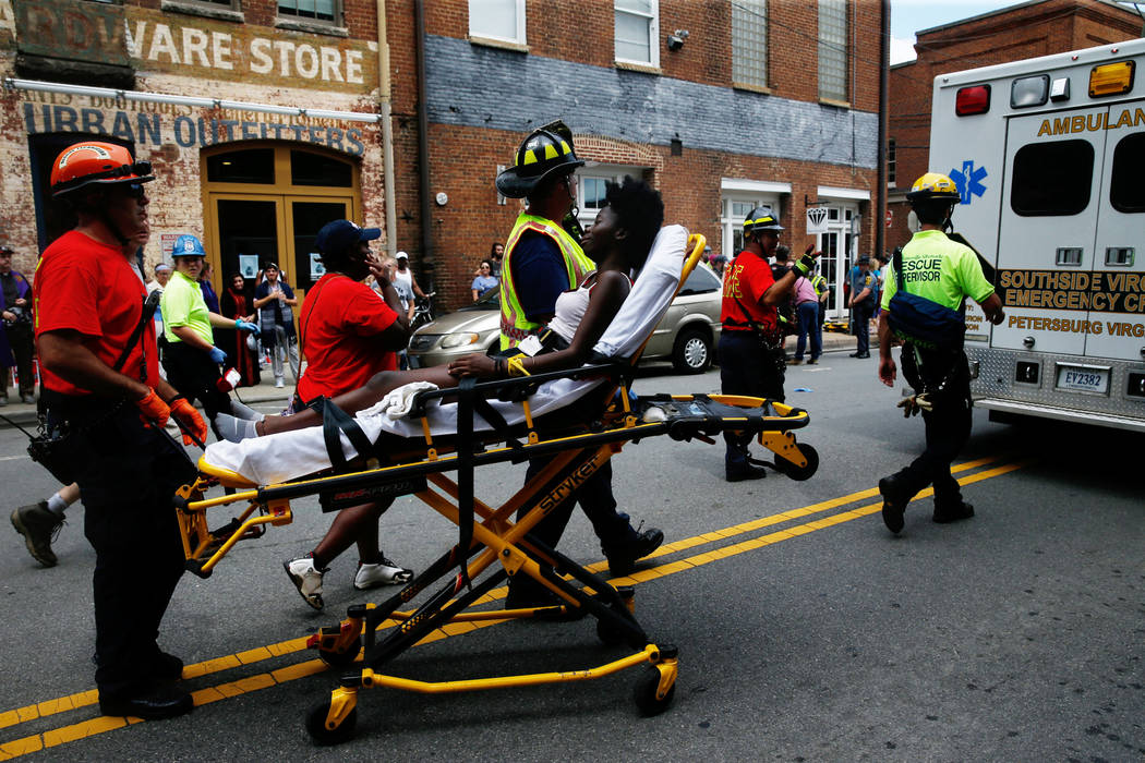 """Rescue workers transport a victim who was injured when a car drove through a group of counter protestors at the """"Unite the Right"""" rally Charlottesville, Virginia, U.S., August 12 ..."""