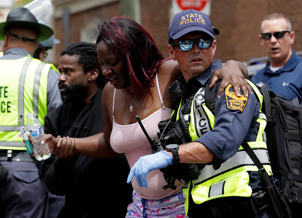 """Rescue workers assist a victim who was injured when a car drove through a group of counter protestors at the """"Unite the Right"""" rally Charlottesville, Virginia, U.S., August 12, 2 ..."""