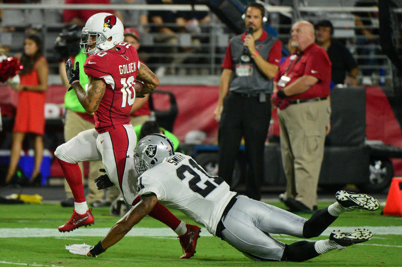 Aug 12, 2017; Glendale, AZ, USA; Arizona Cardinals wide receiver Brittan Golden (10) runs after catching the ball as Oakland Raiders cornerback Sean Smith (21) defends during the first half at Uni ...