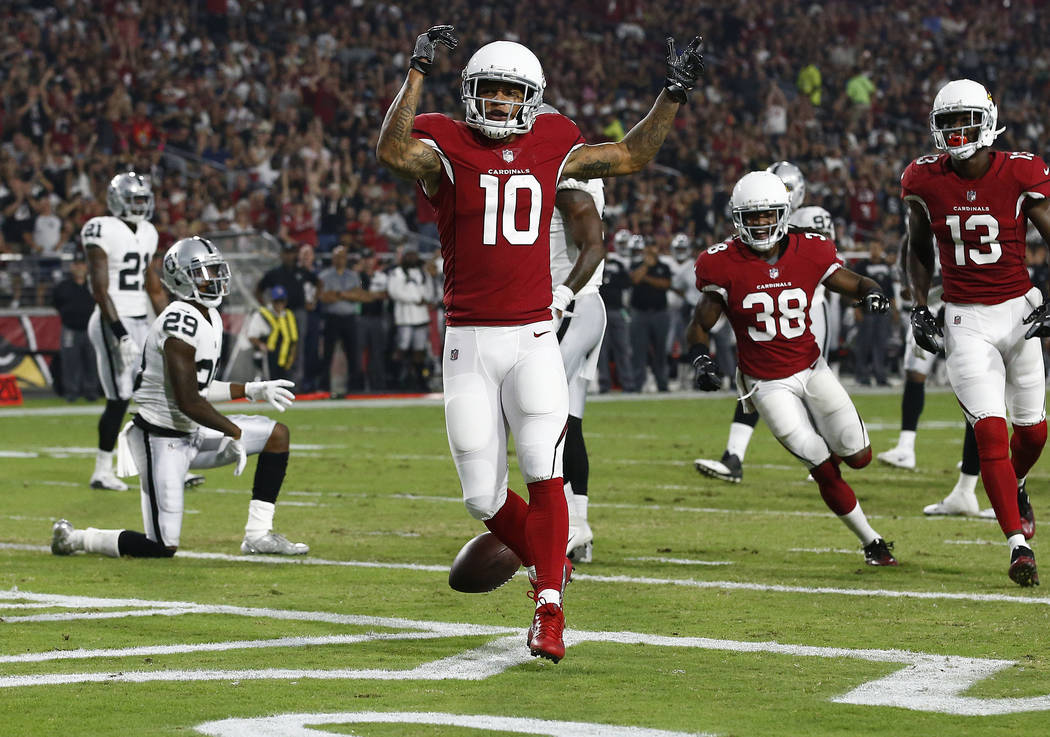 Arizona Cardinals wide receiver Brittan Golden (10) celebrates his touchdown against the Oakland Raiders during the first half of an NFL preseason football game, Saturday, Aug. 12, 2017, in Glenda ...