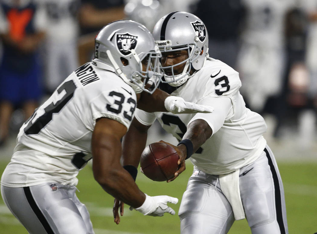 Oakland Raiders quarterback EJ Manuel (3) hands off to DeAndre Washington (33) against the Arizona Cardinals during the first half of an NFL preseason football game, Saturday, Aug. 12, 2017, in Gl ...