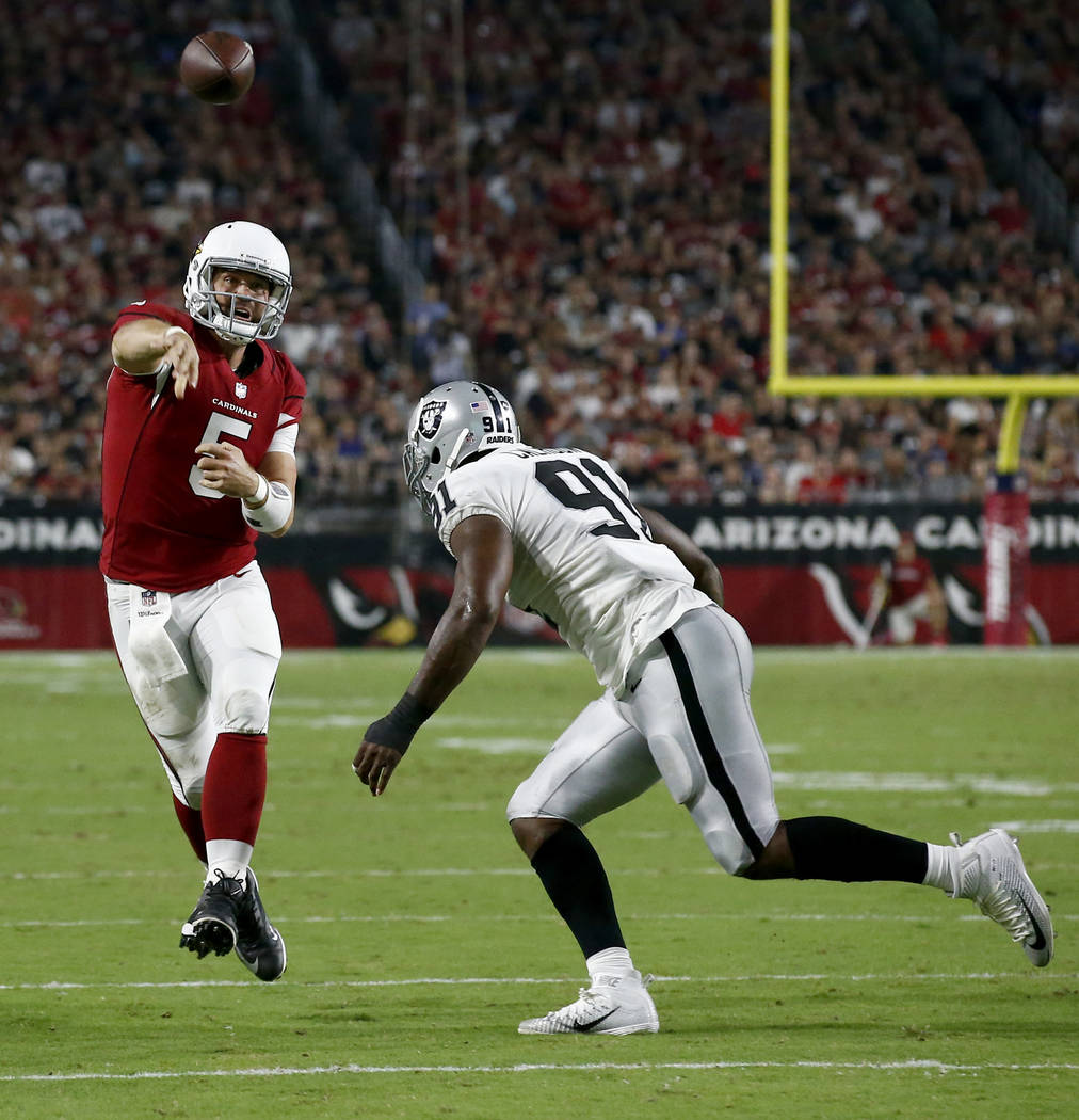 Arizona Cardinals quarterback Drew Stanton (5) throws over Oakland Raiders linebacker Shilique Calhoun (91) for a touchdown during the first half of an NFL preseason football game, Saturday, Aug.  ...