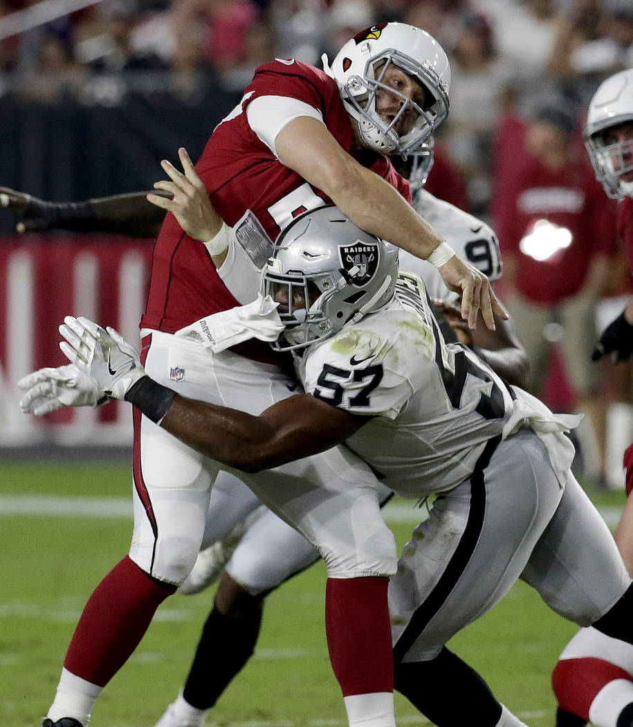 Arizona Cardinals quarterback Drew Stanton (5) is hit by Oakland Raiders middle linebacker Cory James (57) during the first half of an NFL preseason football game, Saturday, Aug. 12, 2017, in Glen ...