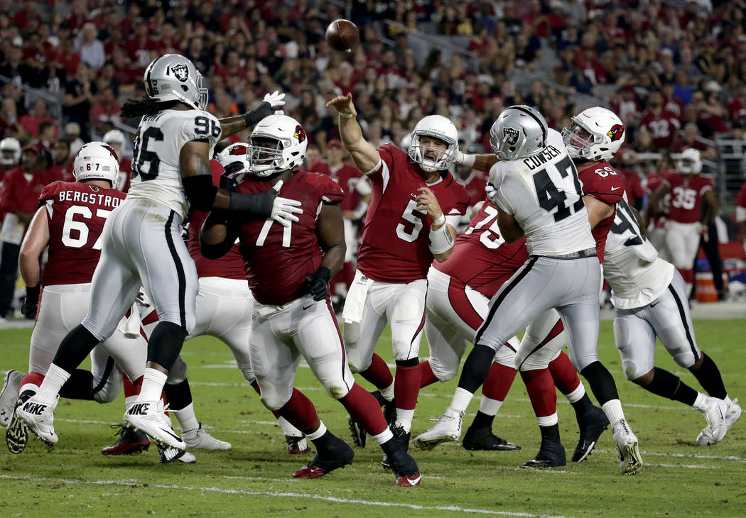 Arizona Cardinals quarterback Drew Stanton (5) throws against the Oakland Raiders during the first half of an NFL preseason football game, Saturday, Aug. 12, 2017, in Glendale, Ariz. (AP Photo/Ric ...