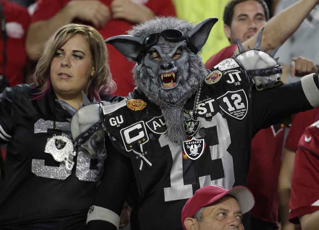 Oakland Raiders fans cheer during the first half of an NFL preseason football game against the Arizona Cardinals, Saturday, Aug. 12, 2017, in Glendale, Ariz. (AP Photo/Rick Scuteri)