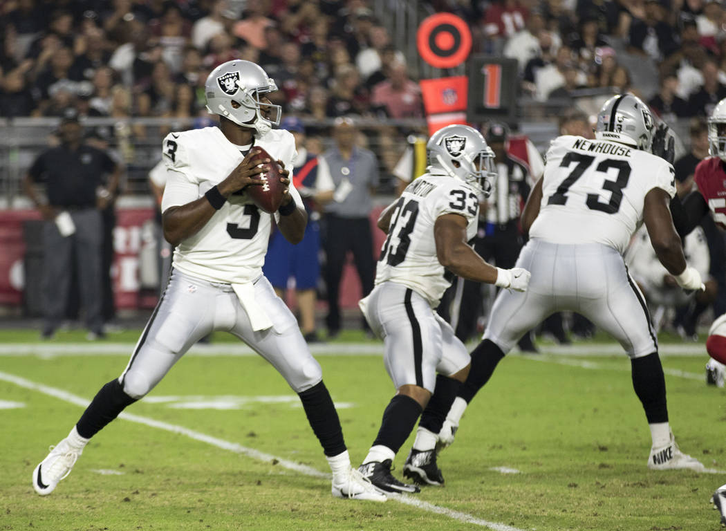 Oakland Raiders quarterback EJ Manuel (3) prepares to throw a pass during the first quarter of an NFL preseason game in Glendale, Ariz., Saturday, Aug. 12, 2017. Heidi Fang /Las Vegas Review-Journal