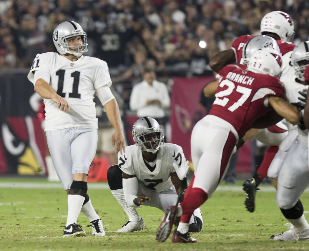 Oakland Raiders kicker Sebastian Janikowski (11) misses a field goal during the first quarter of an NFL preseason game against the Arizona Cardinals in Glendale, Ariz., Saturday, Aug. 12, 2017. He ...