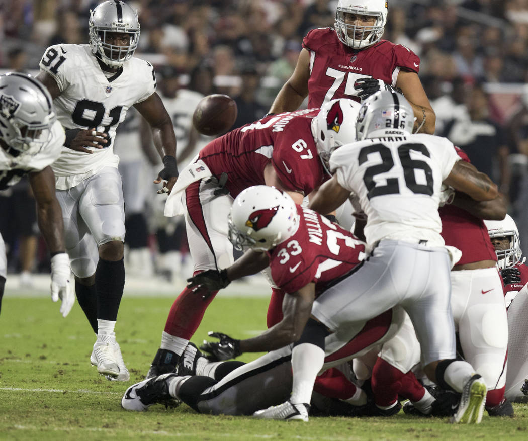 Arizona Cardinals running back Kerwynn Williams (33) fumbles the football during the first quarter of an NFL preseason game in Glendale, Ariz., Saturday, Aug. 12, 2017. Heidi Fang /Las Vegas Revie ...